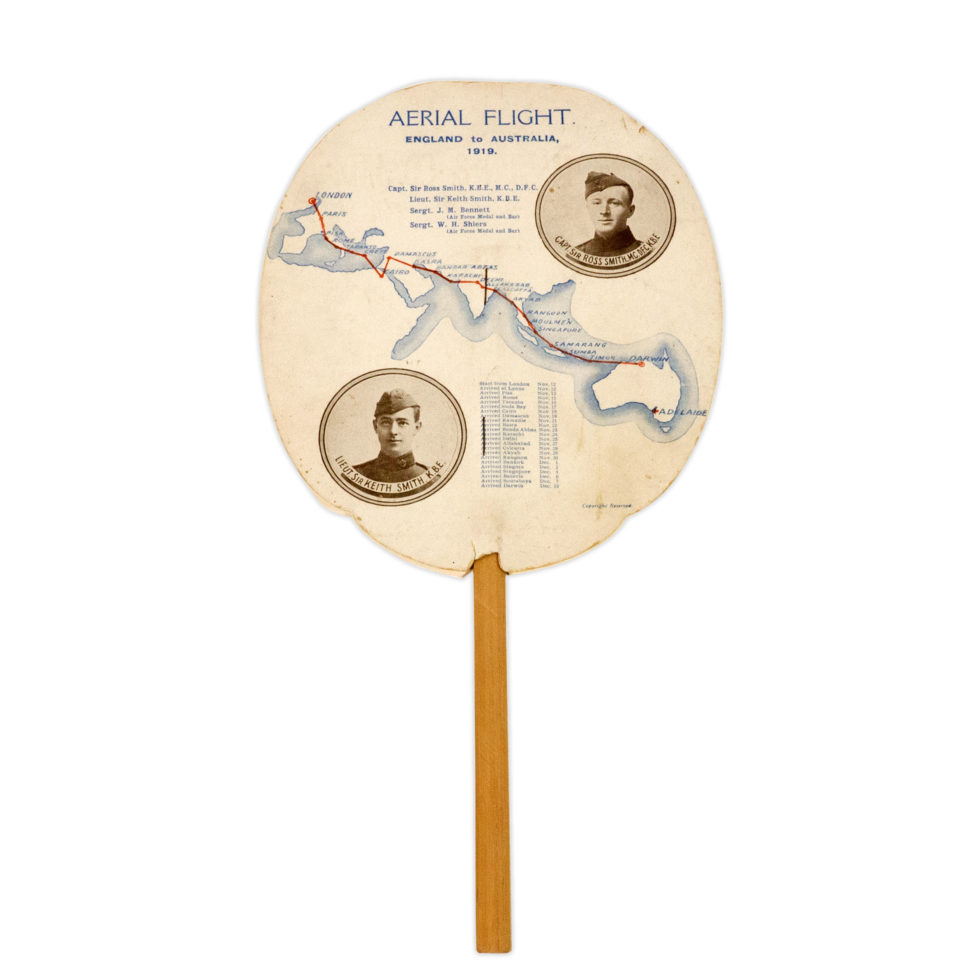 Image: paper fan on a wooden stick